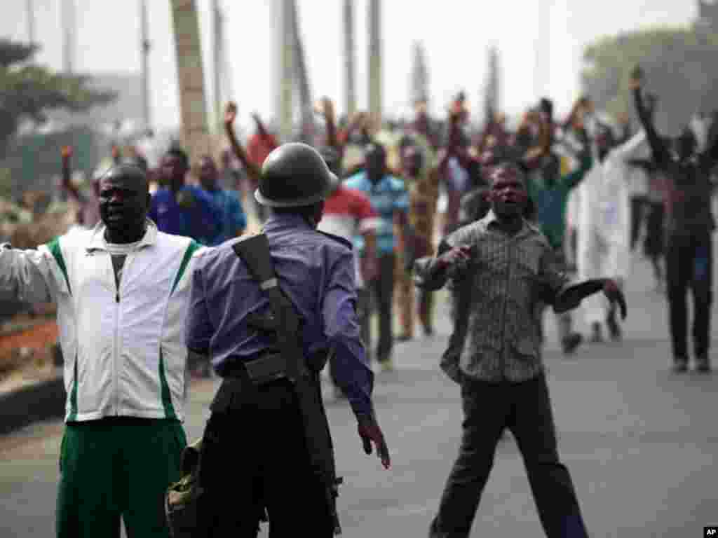 A soldier guards a road during an operation to disperse people protesting against the removal of fuel subsidies in Lagos on January 16, 2012. (Reuters)
