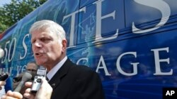 Evangelist Franklin Graham speaks to media in front of his bus after a mass prayer rally on Boston Common, Tuesday, Aug. 30, 2016, in Boston, Massachusetts. (AP Photo/Elise Amendola)