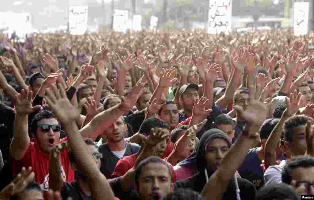 Al Ahli fans take part in a protest march in front of the general prosecutor's office in Cairo. The protesters were calling for the release of their fellow fans, who were arrested earlier last month during clashes with security personnel as the club's handball team returned from Morocco after winning silver in the African Champions League handball tournament.