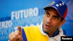Miranda's state governor and opposition leader Henrique Capriles speaks during an interview with Reuters in Caracas February 26, 2014. One month ago, Capriles was Venezuela's undisputed opposition leader, espousing a vision of dialogue and measured dissen