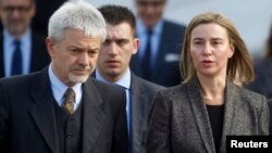 European Union Foreign Policy Chief Federica Mogherini (R) and Deputy Head of the Delegation of the European Union to Bosnia and Herzegovina Renzo Daviddi leave the Parliament building in Sarajevo, Feb. 23, 2015.