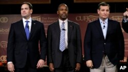 FILE - Republican presidential candidates (L-R) Senator Marco Rubio, retired neurosurgeon Ben Carson and Senator Ted Cruz stand on stage during the Presidential Family Forum, Nov. 20, 2015, in Des Moines, Iowa.