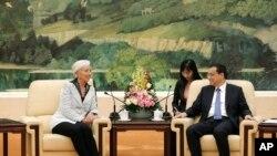 Christine Lagarde, directrice du FMI, et Li Keqiang, Premier ministre chinois, Grand Palais du Peuple, Pékin, Chine, le 24 mars 2014.