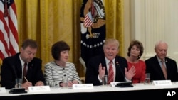 President Donald Trump, center, meets with Republican senators on health care in the White House, June 27, 2017. Seated with him, from left, are Sen. Susan Collins, R-Maine and Sen. Lisa Murkowski, R-Alaska.