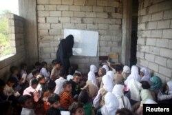 Students attend a class at the teacher's house in Taiz, Yemen, Oct. 18, 2018.