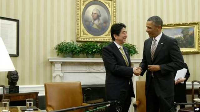 President Barack Obama shakes hands with Japan's Prime Minister Shinzo Abe at the end of their meeting in the Oval Office of the White House in Washington, Feb. 22, 2013.