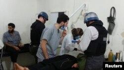 2013年8月26日联合国化武专家检查小组在大马士革几个郊区一个医院访问据指称由叙利亚军队发动化学武器袭击的受害者