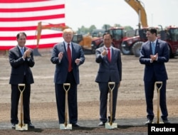 President Donald Trump, along with Terry Gou, founder and chairman of Foxconn, and Speaker of the House Paul Ryan, participate in the Foxconn Technology Group groundbreaking ceremony for its LCD manufacturing campus, in Mount Pleasant, Wisconsin, U.S.