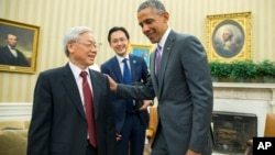 President Barack Obama, right, meets with Vietnamese Communist party secretary general Nguyen Phu Trong in the Oval Office of the White House, on Tuesday, July 7, 2015. (AP Photo/Evan Vucci)