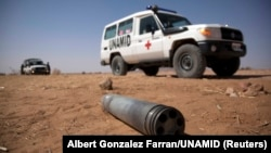 FILE - An unexploded ordnance is seen in North Darfur, March 27, 2011.