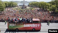 Portugal's winning EURO 2016 team ride in an open bus on their return to Lisbon, Portugal, July 11, 2016.