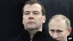 Dmitry Medvedev, left, and Vladimir Putin (File)