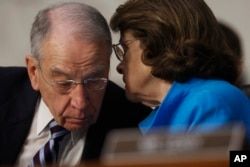 Senate Judiciary Committee Chairman Sen. Charles Grassley, R-Iowa, confers with the committee's ranking member Sen. Dianne Feinstein, D-Calif., on Capitol Hill in Washington, March 20, 2017, during the committee's confirmation hearing for Supreme Court J