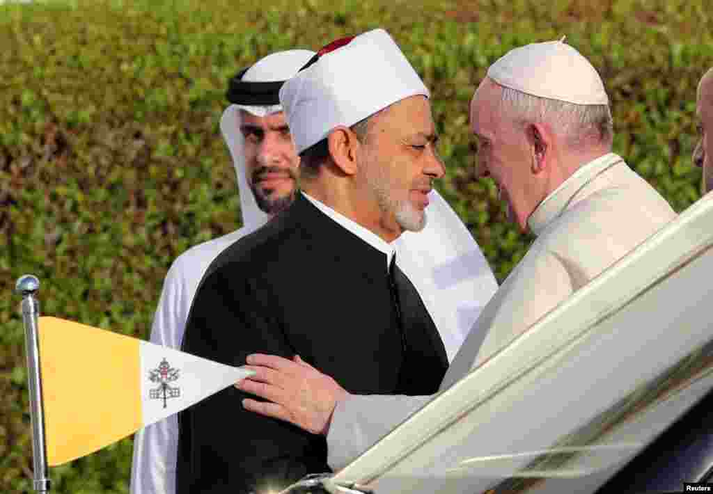 Pope Francis is welcomed by Grand Imam of al-Azhar Sheikh Ahmed al-Tayeb at the sheikh Zayed grand Mosque in Abu Dhabi, United Arab Emirates.