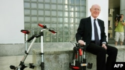 FILE - British inventor Sir Clive Sinclair poses for a photograph during the launch of his A-bike at the Design Museum in London, July 12, 2006.
