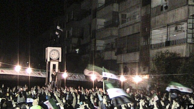 Demonstrators gather during a protest against Syria's President Bashar al-Assad in Homs, February 10, 2012.