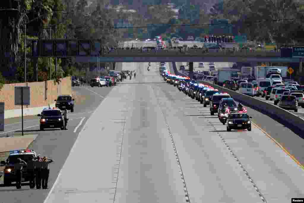 A procession for the body of Sheriff Sgt. Ron Helus, who was shot in a shooting incident at a Thousand Oaks bar, drives along Ventura HIghway 101 in Thousand Oaks, California. Twelve were killed by a gunman late Wednesday during a shooting at the bar. Helus was immediately hit with numerous gunshots after going inside to confront the shooter, and her died after being taken to a hospital.