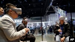 Attendees try the new Oculus Go goggles during F8, Facebook's developer conference, Tuesday, May 1, 2018, in San Jose, Calif. (AP Photo/Marcio Jose Sanchez)