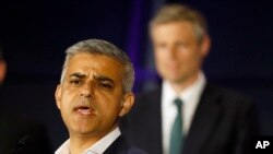 Sadiq Khan, Labour Party candidate, speaks in front of Zac Goldsmith, Conservative Party candidate, after winning the London mayoral elections, at City Hall, London, May 7, 2016.