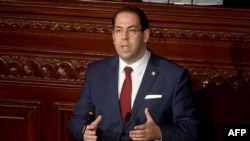 FILE - Tunisian Prime Minister Youssef Chahed speaks to the parliament in Tunis, Nov. 21, 2017.
