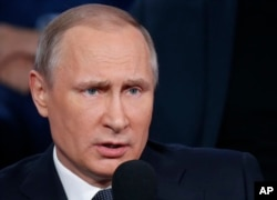 FILE - Russian President Vladimir Putin during media forum.