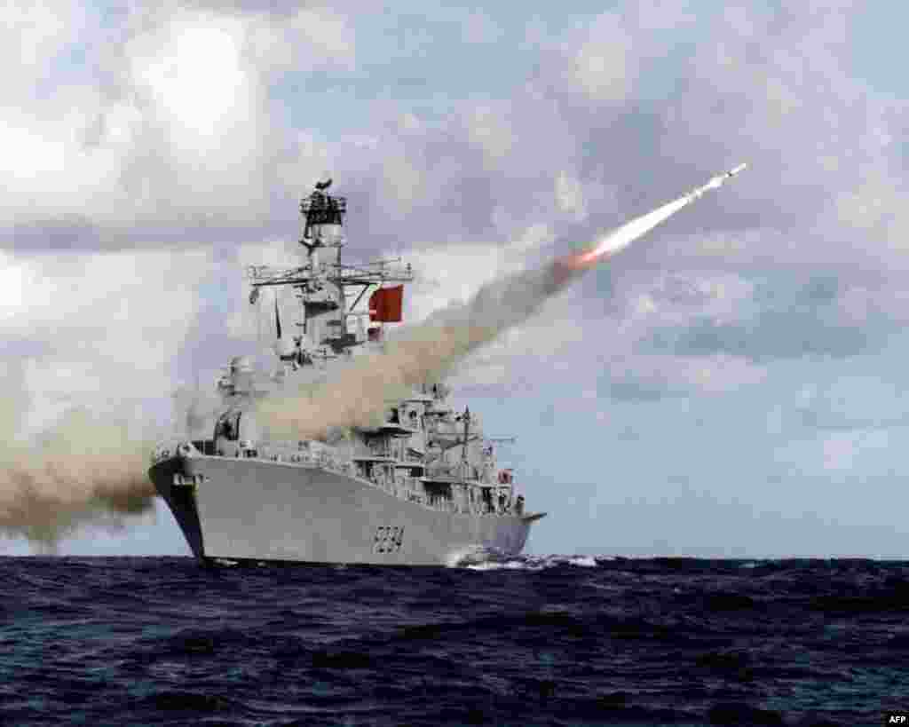 In this handout picture retrieved from the British Ministry of Defence (MOD) via Defence News Imagery the British Royal Navy Type 23 frigate, HMS Iron Duke, is pictured at sea firing her Harpoon anti-ship missile.