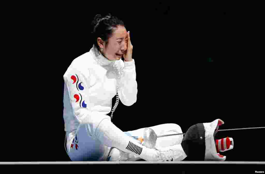 South Korea's Shin A Lam reacts after being defeated by Germany's Britta Heidemann during their women's epee individual semifinal fencing competition at the ExCel venue.