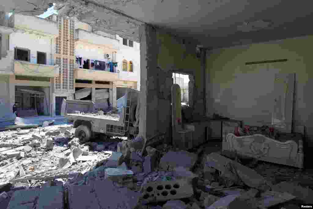 A general view shows damage at a site hit by airstrikes on Tuesday in the town of Khan Sheikhoun in rebel-held Idlib, April 5, 2017.