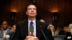 FILE - FBI Director James Comey prepares to testify on Capitol Hill in Washington, May 3, 2017.