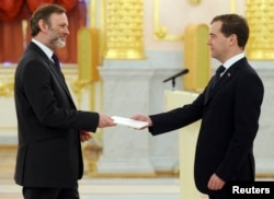 FILE - Russia's President Dmitry Medvedev, right, speaks with Tim Barrow, Britain's ambassador to Russia, during a ceremony in which newly appointed ambassadors present their credentials, in Moscow's Kremlin, Dec. 7, 2011.