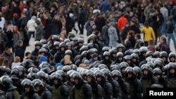 FILE - Law enforcement officers gather as they block opposition supporters in Moscow, Russia, March 26, 2017.