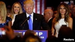 Republican presidential candidate Donald Trump smiles as he speaks at the start of a campaign victory party after Senator Ted Cruz dropped out of the race for the Republican presidential nomination. Ohio Governor John Kaisich also dropped out, leaving him the only Republican candidate standing.
