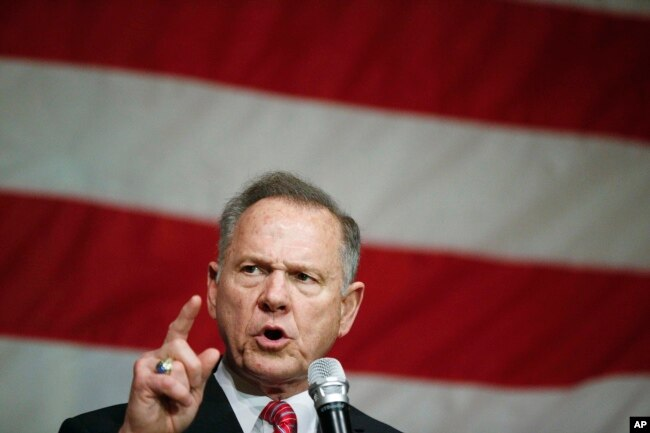 FILE - Former Alabama Chief Justice and U.S. Senate candidate Roy Moore speaks at a campaign rally, Dec. 5, 2017, in Fairhope, Ala.