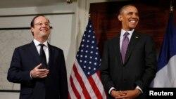 Prezida wa Amerika, Barack Obama na prezida w'Ubufransa, Francois Hollande mu rugendo rwiwe i Washington DC