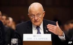 FILE - Director of National Intelligence James Clapper testifies on Capitol Hill in Washington, Feb. 9, 2016.