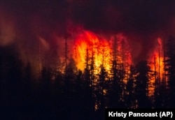The Howe Ridge Fire burns at Glacier National Park, Montana.