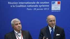 French Foreign Affairs Minister Laurent Fabius (r) and Syrian National Coalition vice-president Riad Seif attend a press conference during the International support meeting of the Syrian National Coalition in Paris, Jan. 28, 2013.