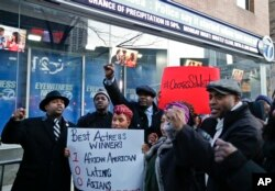 Protestors gather outside of the offices of WABC-TV to rally for more diversity in the film industry, Feb. 28, 2016, in New York.