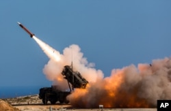 FILE - A Patriot weapons system is fired at the NATO Missile Firing Installation in Chania, Greece.