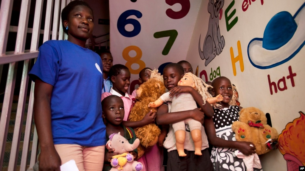 Uganda tightens foreign adoption rules file ugandan children orphans among them are seen at a clinic in kampala ccuart Gallery