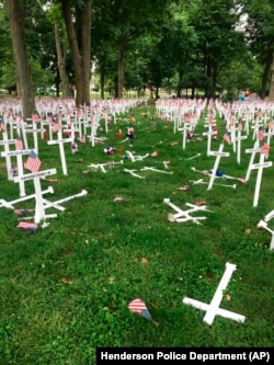 A Memorial Day display of crosses is destroyed after a vehicle drove through them in Henderson, Kentucky's Central Park, May 28, 2016. The display honors the names of more than 5,000 from the city and county of Henderson who served in conflicts dating back to the Revolution.