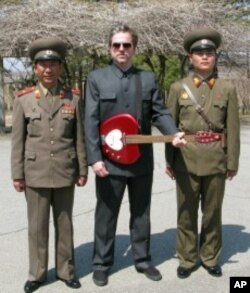 "Artist Morten Traavik, center, poses in Pyongyang as a touring rock musician for his 2010 exhibit ""Rock Steady North Korea."""