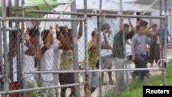 Những người xin bảo hộ tị nạn tại một trại tạm giữ trên đảo Manus, 21/3/2014.