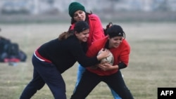FILE - In this photograph taken on Jan. 18, 2017, Pakistani rugby players take part in a practice session in Lahore.