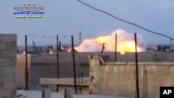 FILE - Smoke rising after a Russian airstrike hit buildings in the town of Latamna in the area of Hama in Eastern Syria, Oct. 7, 2015.