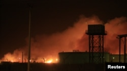 Fire engulfs the Yarmouk ammunition factory in Khartoum, Sudan, October 24, 2012.
