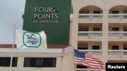 "A U.S. flag and a flag of the Cuban military-run hospitality company Gaviota flutter near the logo of a ""Four Points by Sheraton"" hotel in Havana, Cuba, June 27, 2016."