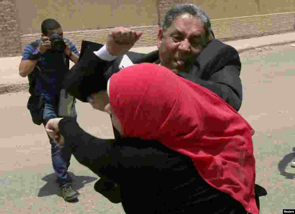 A fight breaks out between defense lawyers and family members of victims outside a court in Cairo. An Egyptian court sentenced 11 men to death for their part in the country's worst violence at a football stadium, which killed more than 70 fans and injured at least 1,000 in 2012.