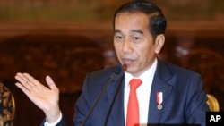 Indonesia President Joko Widodo gestures as he speaks during a press conference at the palace in Jakarta, Indonesia, Monday, Aug. 26, 2019. Indonesia's president has announced to relocate the country's capital.