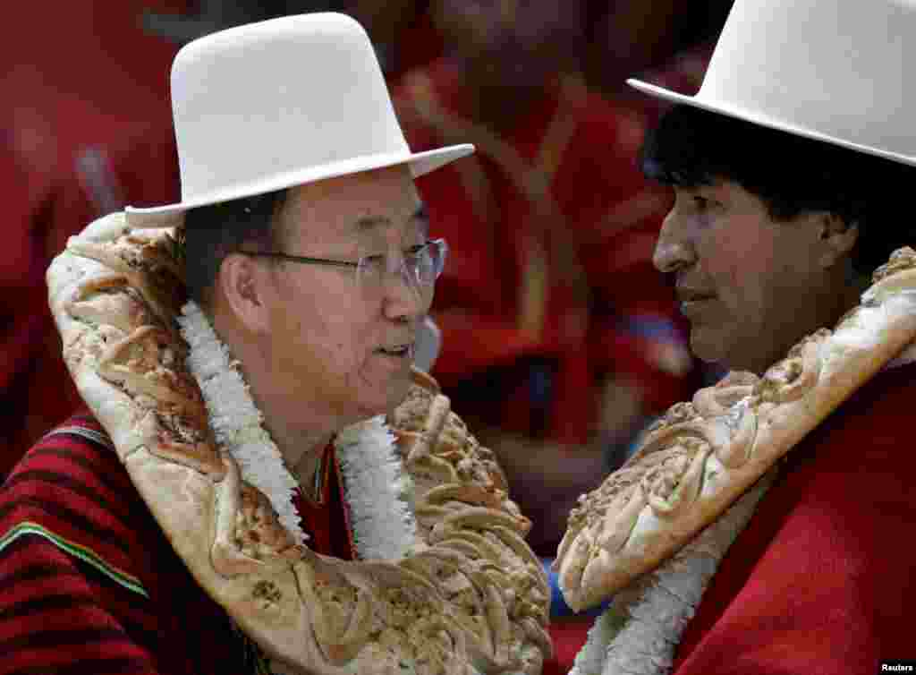 "U.N. Secretary-General Ban Ki-moon (L) talks with Bolivia's President Evo Morales during the inauguration of a sports arena called ""Coliseo Ban Ki-Moon"" in Vila Vila, south of Cochabamba, Oct. 11, 2015. Ban Ki-Moon is in Bolivia for the World People's Conference on Climate Change and the Defense of Life."